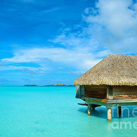 IPics Photography - Luxury thatched roof over-water bungalow