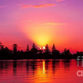 Geoff Childs - Magenta Sunrise over Water.  Art photo digital download and wallpaper screensaver. DIY Print.