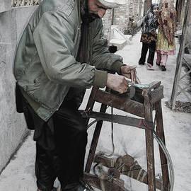 Lenore Senior and Bobby Dar - Man and Sharpening Machine
