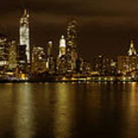 Angela A Stanton - Manhattan from Brooklyn with the Brooklyn Bridge and full moon