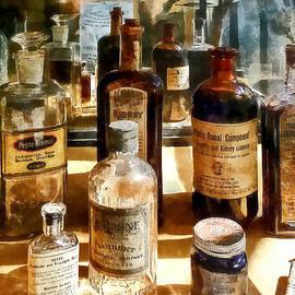 Susan Savad - Medicine Bottles in Glass Case