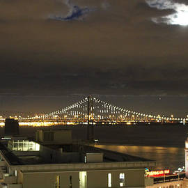 Ron McMath - Moon burst over San Francisco Oakland Bay Bridge
