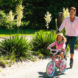 Robert Ford - Mother and Daughter Biking and Rollerblading in Holland State Park Holland Michigan