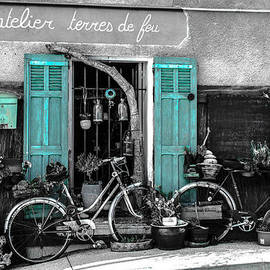 Dany Lison - Old bicycles and blue shutters