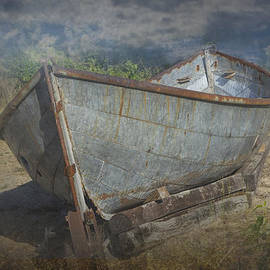 Randall Nyhof - Old Historical Fishing Boat beached on the shore