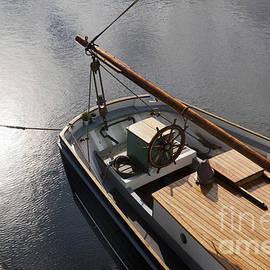 Paul Felix - Pale autumn sunlight on the surface of water beside at tallship