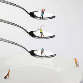 Paul Ge - People playing golf on spoons little people on food