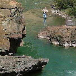 Karen Rispin - Phil fly fishing the Bighorn