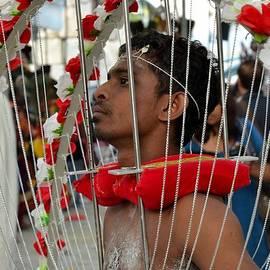 Imran Ahmed - Pierced Hindu devotee wears Kavadi at Thaipusam Singapore