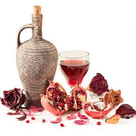 Sviatlana Kandybovich - Pitcher and pomegranate juice in a glass