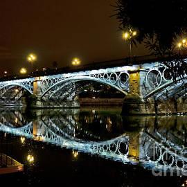 Carlos Alkmin - Puente Isabel II at night - City of Sevilla