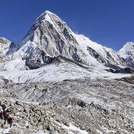 Robert Preston - Pumori mountain with the black rock of Kala Pathar in front of it in the Everest Region of Nepal