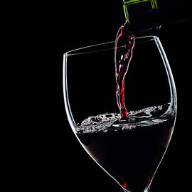 Red Wine Pouring Into Wineglass Splash Silhouette