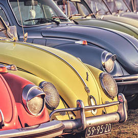 Martin Bergsma - Retro styled image of a row of vintage Volkswagen Beetles