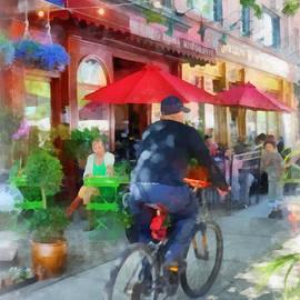 Susan Savad - Riding Past the Cafe