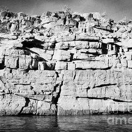 Joe Fox - rock strata on the banks of the colorado river bottom of the grand canyon Arizona USA