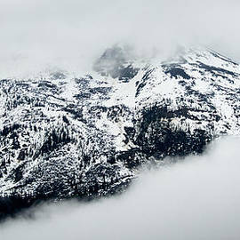 Rocky mountain surrounded by fog