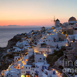 Matteo Colombo - Romantic sunset over the village of Oia Greece Santorini
