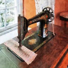 Susan Savad - Sewing Machine Near Lace Curtain