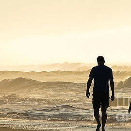 Jo Ann Tomaselli - Silhouetted Father and Son Walk Beach