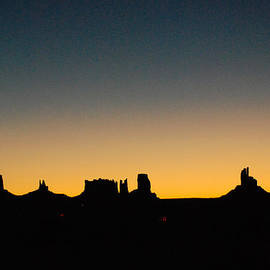 Robert Ford - Silhouettes of Monument Valley skyline before Dawn from Gouldings Trading Post Utah