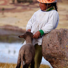 RicardMN Photography - Sillustani Girl with hat and lamb