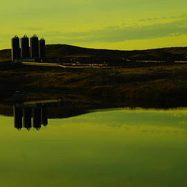 Jeff  Swan - Silos reflecting in a pond