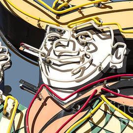 John Wayland - Smoking Cowboy Vintage Neon Sign In Las Vegas Nevada - Day