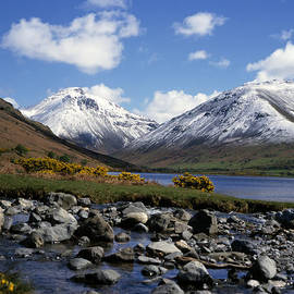Snow covering the summits of Great Gable  and Lingmell whilst sunlight illuminates Wast Water in the