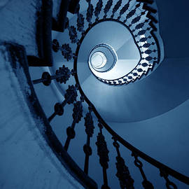 Jaroslaw Blaminsky - Spiral staircase in dark blue tones