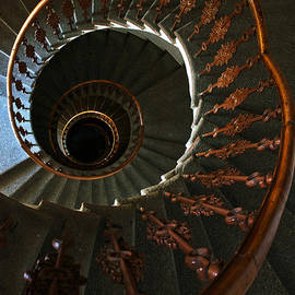 Jaroslaw Blaminsky - Spiral stairs in dark brown tones