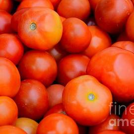 Imran Ahmed - Stack of numerous tomatoes
