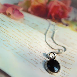 Jaroslaw Blaminsky - Still life with roses and a black pendant