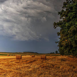 Julis Simo - Storm Clouds over Harvested Field in Poland