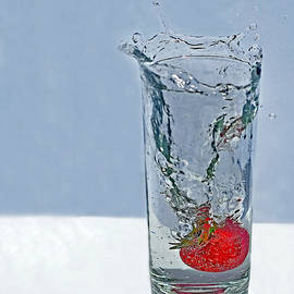 Valerie Garner - Strawberry Splashing into Glass of Sparkling Water