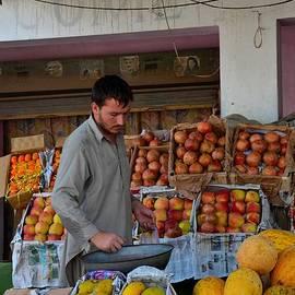 Imran Ahmed - Street side fruit vendor Islamabad Pakistan