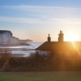 Matthew Gibson - Sunrise over coastguard cottages at Seaford Head with Seven Sist