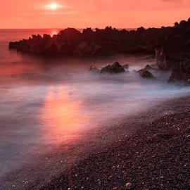 Nature  Photographer - Sunset at Kahako Bay - Orange sunset on the shore of Kauhako Bay on the Big Island
