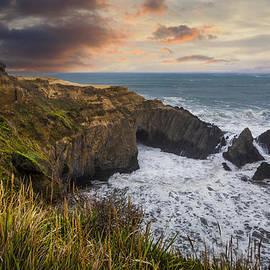 Debra and Dave Vanderlaan - Sunset over the Oregon Coast