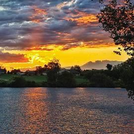 Lynn Hopwood - Sunset through the clouds