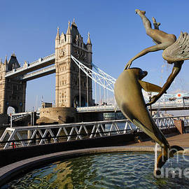 Robert Preston - Tower Bridge and Girl Playing With Dolphin statue