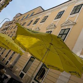 Georgia Mizuleva - Vienna Street Life - Cheery Yellow Umbrellas at an Outdoor Cafe
