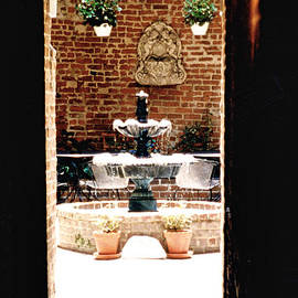 Glenn Aker - View of Courtyard Fountain Through Archway
