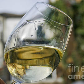 White wine swirling in a glass