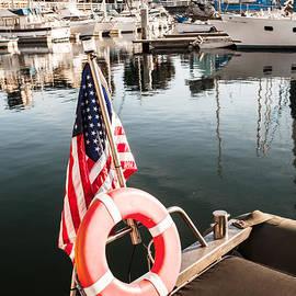 Sviatlana Kandybovich - Yacht with American flag At The Pier