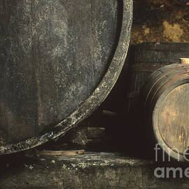 Bernard Jaubert - Barrels of wine in a wine cellar. France