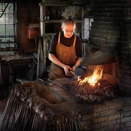 Mike Savad - Blacksmith - Blacksmiths like it hot