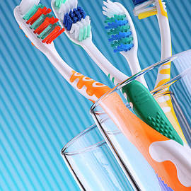 T Monticello - Composition with four toothbrushes on blue background