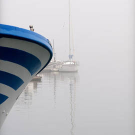 Pedro Cardona - foggy days 1 - a fishing boat and a vessel in a foggy day at Port Mahon