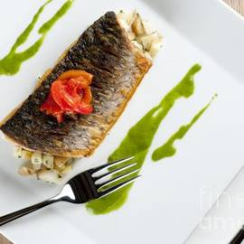 Andy Smy - GREY MULLET WITH WATERCRESS SAUCE presented on a square white plate with cutlery and napkin